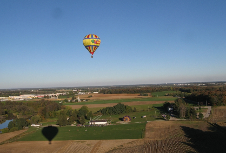 Picture of hot air balloon above field