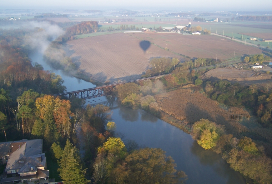 Picture from a flight above a river and bridge
